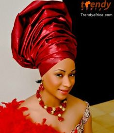 This looks like a haze gele ensemble.It is quite high for a traditional gele, however this is balanced by the tapering jawline .