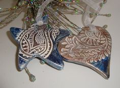 2 Stamped Pottery Ornaments in Blue Copper and German Silver Gilders Paste Paisley Heart and Star. $16.00, via Etsy.