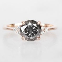 Our signature look. A gorgeous natural translucent black diamond center in our Imogene ring that features six white diamonds in triangle… Cute Engagement Rings, Cute Jewelry, Unique Jewelry, Black Diamond, White Diamonds, Beautiful Wedding Rings, Dream Wedding, Dream Ring, Promise Rings