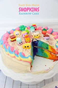 You& never believe how easy it is to make this stunning Rainbow Shopkins Cake! Perfect for your favorite Shopkins fan or for a themed kids birthday party! Shopkins Rainbow Cake, Pastel Shopkins, Fete Shopkins, Shopkins Cake, Cake Rainbow, Shopkins Birthday Cake, Kids Rainbow, Easy Birthday Cake Recipes, Rainbow Birthday