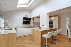Superior White Walls Oak Units White Cupboard Fronts Wooden Floor White Work Top ·  Open Plan KitchenOpen ...