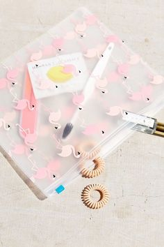 UO Flamingo Cosmetics Pouch. Click the link to shop right now for your next travel adventure! <3 #travel #digitalnomad #flight #adventure #wanderlust #travelhacks
