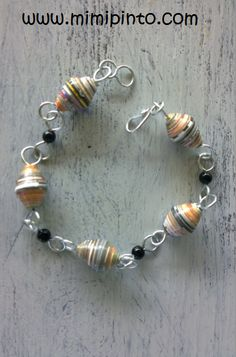 #fashion #jewelry Mardi Gras Harlequin Bracelet Multi coloured stripes circumference the Paper beads, with tiny Black acrylic beads inbetween. The Bracelet has a large easy hook clasp, easy on arthritic fingers. The easy hook fits into all the loops in the bracelet, hence making it suitable for all wrists £9.30 on #amazonUK http://www.amazon.co.uk/s/ref=nb_sb_noss_1?url=search-alias%3Djewelry&field-keywords=mimi%20pinto&sprefix=mimi+%2Cjewelry