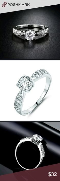 Beautiful Solitaire with Smaller CZ's on the Sides A fantastic Solitaire ring to use as an engagement ring  or just because you love it. SS 925 ring with smaller stones on each side of the center stone.   Non smoking/ pet friendly home Boutique  Jewelry Rings