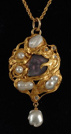 gold carved amethyst head and baroque pearl art nouveau rare pendant 1900c