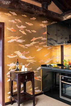 Editors' Picks: 96 Off-the-Wall Fabrics and Wallcoverings   Fishes in Koi Design on Deep Rich Gold Gilded wallpaper by De Gournay #design #interiordesign #interiordesignmagazine