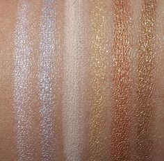 MAC Technakohl Liner swatches from the left: Snowed In, Sterling Silver, Risque, Bare Asset, Twinked, Brass Band and $$$