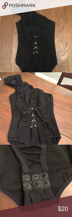 Tripp black one shoulder corset bodysuit top m Black lace up front corset style bodysuit with lace bow shoulder. One shoulder style with adjustments at shoulder for fit with bow detail and snaps at the bottom as well. Back zip. Stretch cotton poly blend. Silver hardware. Size Medium Tripp nyc Tops Blouses