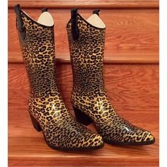 Cheetah Corkys Rain Boots These women's Corkys rain boots feature a HOT Cheetah pattern and Western design that stands out from the crowd. Gift that didn't fit. Brand New but Box was damaged in shipping. Will happily send in boot storage box is asked Western design With Waterproof rubber construction. Rubber upper & outsole with Fabric lining. Pointed toe & Padded footbed  HP @1hermitcrab 1/29 ·         2-in. heel ·         11-in. shaft ·         11-in. circumference. Corkys Shoes Winter…