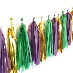 The perfect decoration for your Mardi gras masquerade ball. Add some bubbly and a mask and you are ready to party. Our Mardi Gras tassel garland is emerald green, deep purple and metallic gold, exactl