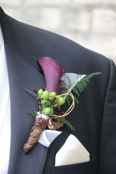 Dark Plum/purple mini calla, green Hypericum berries. Boutonniere created by Judith Marie at Fox Bros Floral, Hartland, WI