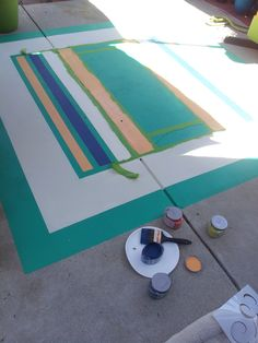 Painting A Rug On The Concrete Patio