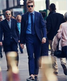Navigating the streets of New York, Jesse Shannon wears a Salvatore Ferragamo suit with a Canali shirt, Turnbull & Asser tie and sunglasses.