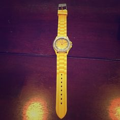Geneva yellow watch Yellow silicone strap and silver band watch. You will need a new battery for this! Geneva Accessories Watches