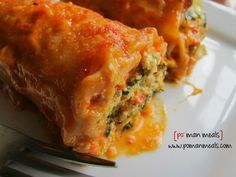 spinach lasagna rolls with roasted red bell pepper alfredo sauce on http://www.pomanmeals.com