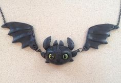 Original hand sculpted Toothless inspired necklace.    Durable lightweight resin and black metal chain.    Please message me with any questions