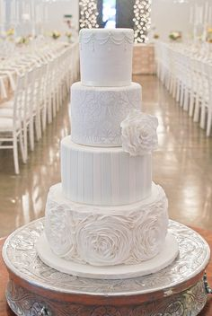 White wedding cake, different designs for every tier.