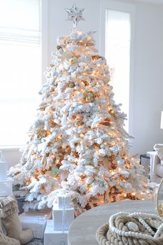 Design by Monika Hibbs. A white Christmas tree can be modern, traditional, rustic, or zen, - it's all about the way you decorate it.