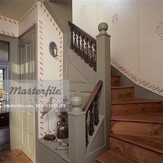 Stairs: classic colonial design, copied from original in New England, banisters painted historic accurated medium green, small entry hall, stenciling  – Image © Sheltered Images / Masterfile.com: Creative Stock Photos, Vectors and Illustrations for Web, Mobile and Print