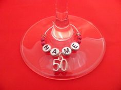 Personalised 50th Birthday Wine Glass Charm with Name by Libby's Market Place Libby's Market Place http://www.amazon.co.uk/dp/B00C3ZS386/ref=cm_sw_r_pi_dp_XVGsvb0MS7JVV