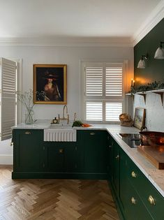 quirky home decor This Shaker kitchen was fitted in a lovely home in Paddington, London. What a dreamy space it is, we love the dark green cabinet colour and the honed Statuarietto marble worktop, splashback and shelf.