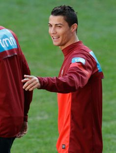 Portugal's Cristiano Ronaldo gestures as he walks onto the pitch for a training session, Sunday, Nov. 17 2013, at the Luz stadium in Lisbon. Portugal will play Sweden on Tuesday in a World Cup qualifying playoff second-leg soccer match. (AP Photo/Armando Franca)