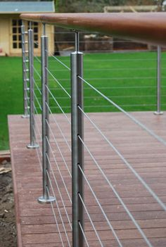 Stainless steel tubular and hardwood balustrade, wire rope infill Deck Balustrade Ideas, Outdoor Handrail, Wood Deck Railing, Garden Railings, Interior Stair Railing, Glass Balustrade, Staircase Railings, Glass Railing, Cable Railing