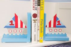 Ships Bookends  Adorable ships bookends from the Gisela Graham ships range, made of wood and painted all pale blue. In the middle of each of the bookends there is one large boat shape painted white with red port holes and red, white and blue sails. | Childrens Bed Centres