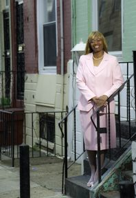 """""""Career Wardrobe does give you that motivation. That push. And the clothing really makes you feel good about yourself. Yes it does.""""    Ernestine standing on HER front stoop in Philadelphia. Career Wardrobe helped her when she needed support. #storyofasuit"""