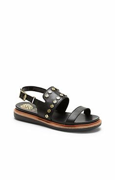 Hennah-Causal flat sandals are taking the fashion world by storm! The studded Hennah works in the key to comfort with a cushioned footbed and an open back. A three-part sole and nail-head accents highlight the chicness of this Vince Camuto shoe.