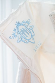 Planning on treasuring your dress forever? Have a blue monogram embroidered in with your wedding date!