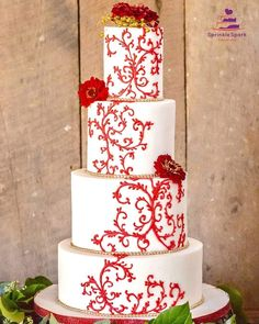 #Fall #WeddingCake in beautiful hand piped #RoyalIcing #Scrollwork with bright red on white cake decorated with fresh flowers. Photography by  RK Arts Studio Event:Organizer: Adrienne Eichner Florist:  Honey Bees Florist