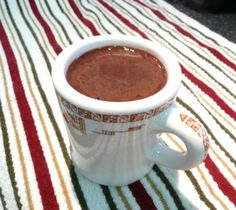 I love the almondy taste of this hot chocolate. This recipe makes one cup; just double or quadruple (or whatever) the recipe to make what you need. Also tasty with a dash of cinnamon and cloves stirred in.