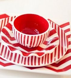 red dinnerware table setting. Find it ...at Mary's!!!