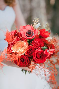 bold red rose and anemone bouquet by Cup of Roses