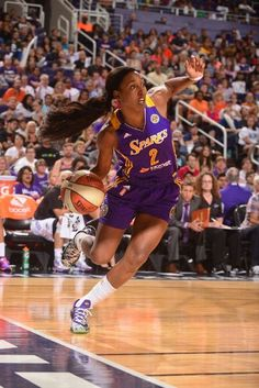 newest f80ba daded Candice Wiggins  2 of the Los Angeles Sparks drives to the basket against  the Phoenix