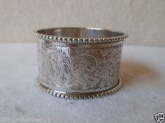 LOVELY ANTIQUE CHASED SOLID SILVER NAPKIN RING WALKER & HALL 1904