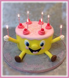 A very happy smiley Birthday Cake. Perfect for a children's party.