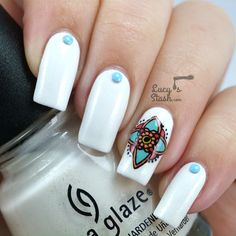 Brighten up one or two nails with a colorful design, like this one that's reminscent of a henna tattoo. Lucy's Stash got this look by creating a decal with a nail stamp, but you could also put your artistic skills to use and paint the motif with a small nail art brush. For an extra touch, add studs to the plain nails.