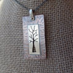 Rustic hand sawed copper & sterling tree pendant by RustyWing