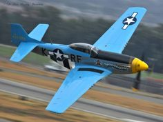 """""""Six-Shooter""""  5/5/13-Planes of Fame Airshow-Chino, Ca: Veteran warbird/ex-race pilot~Chuck Hall puts his beautiful Ramona, CA-based Cavalier II F-51D Mustang~""""Six-Shooter"""" (NL2580/#67-22580) through its' paces~executing a splendid fly-past for the airshow crowd. (Copyright 2013-Don 'Bucky' Dawson)"""