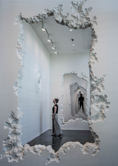 Daniel Arsham installation at the SCAD Museum of Art includes a series of faux concrete walls, which appear to have been blasted through