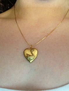 http://www.etsy.com/shop/ForLongerThenForever?ref=pr_shop_more  The Swan princess necklace (locket) :)