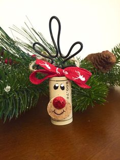 Set of 4 adorable wine cork reindeer ornaments. These can be used to decorate your tree or given as a gift. Wine lovers will go crazy over this little cork reindeer. Perfect and totally unique hostess or Yankee Swap gift for all those parties youll be attending during the holiday season. This decoration was made with loving thoughts of Rudolph. Their red glitter noses make them pop with Christmas spirit! Add these reindeer ornaments to your gift packages or cookie swaps for a loving…