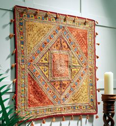This stunning beaded and mirrored wall hanging transforms a dull room into a room full of warmth and ethnic charm. This beautiful wall hanging is so i.