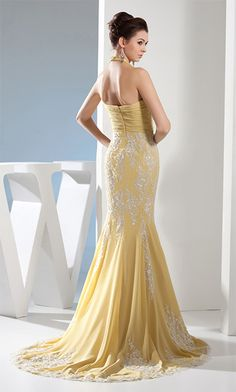 Sexy halter neck yellow prom dress. Love the lace details.