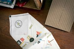 These scavenger hunt-inspired handkerchief invitations could easily be recreated with iron-on transfers.