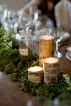 Table centerpiece- Birch bark candles and moss center moss table runner w/wood candle holders Diy Centerpieces Cheap, Long Table Centerpieces, Rustic Wedding Centerpieces, Centerpiece Ideas, Terrarium Centerpiece, Wedding Decorations, Moss Wedding Decor, Lavender Centerpieces, Candle Decorations