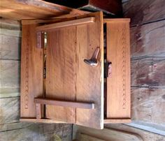 Corner cabinet with wooden hinges and latch.