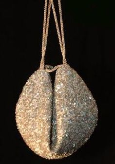 A fortune cookie purse! The example is a mega-luxe beaded designer creation, but Mr. Weekend Designer shows us how to make our own!
